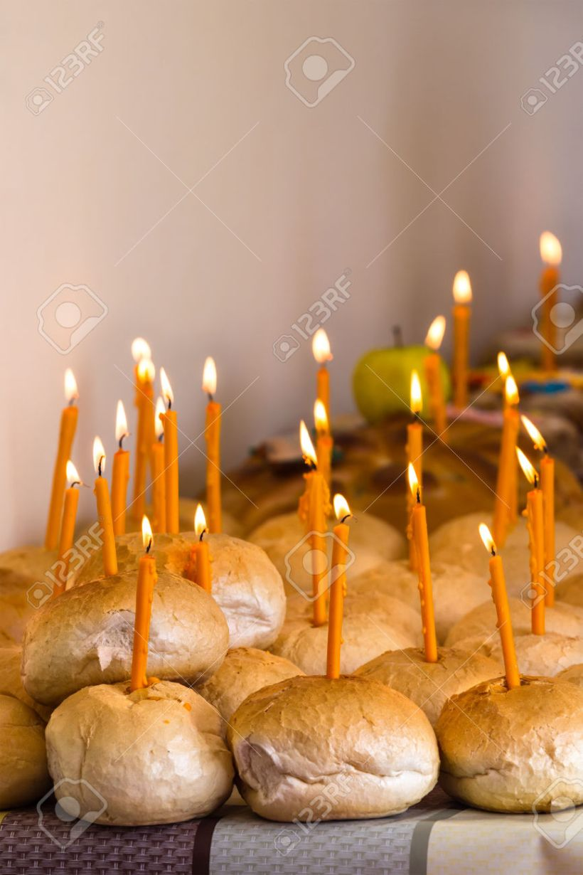 Many breads with lighted candles